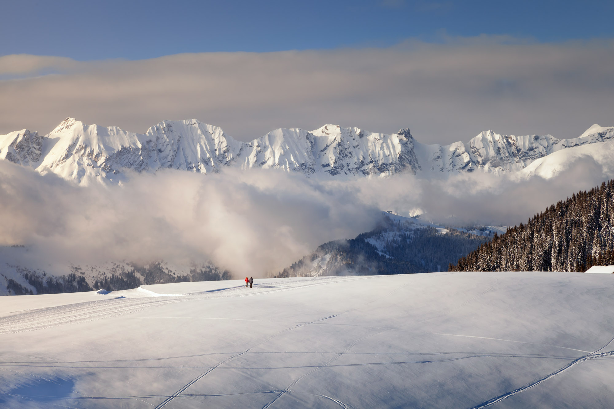 Mountains and Two People Walking, Megeve, France