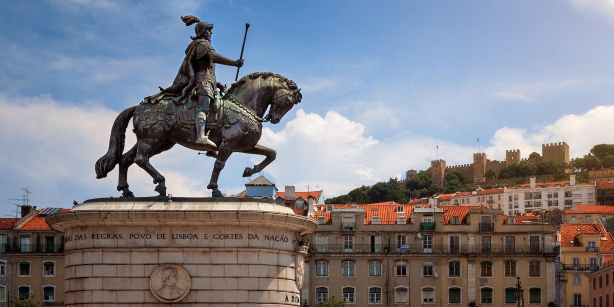 Statue of King John I and Sao Jorge Castle, Lisbon, Portugal